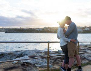 Mature embracing Bondi Australia
