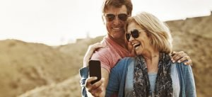 Woman dating a divorced man smiles with him for a selfie