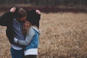 A cuddling couple in the cornfield realize they have the best dating coach.